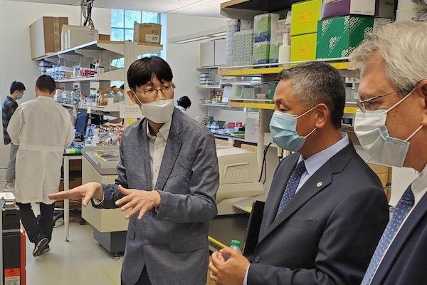 Washington University in St. Louis Professor Tae Seok Moon (left) shows his bioengineering lab to Ed Chu, EPA region 7 acting administrator (center).
