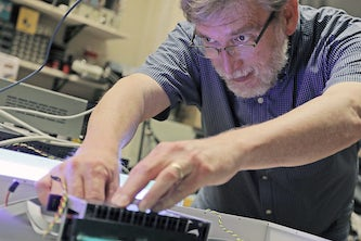 James H. Buckley, professor of physics in Arts & Sciences, received a $4.9 million award from NASA to build a demonstration version of a large satellite experiment for gamma-ray astronomy research. (Photo: Tom Malkowicz)