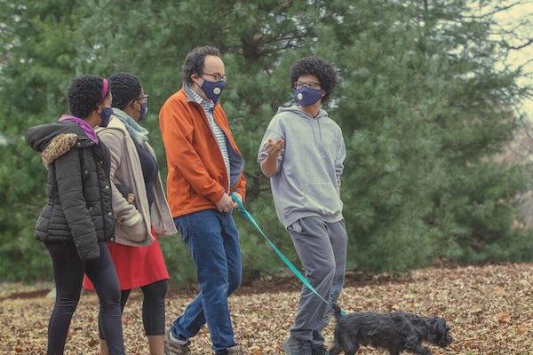 The Nussinov family — (from left) Maya, Tsitsi, Zohar and Ethan — walking their dog, Pi, in Clayton's Oak Knoll Park. (Photo: Joe Angeles/Washington University)