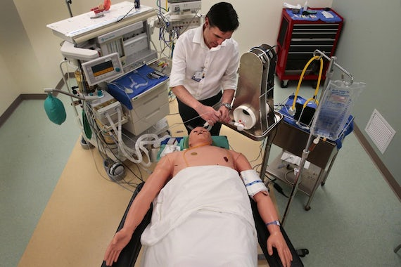 Dr. Broc Burke, who teaches and practices cardiothoracic anesthesiology at WashU, tests an emergency ventilator on a simulator mannequin in the Clinical Simulation Center at Barnes-Jewish Hospital on Friday, April 10, 2020. Photo by Robert Cohen