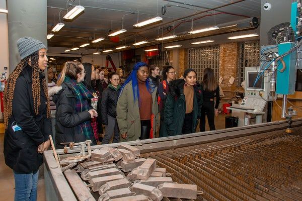 Students tour MADE STL during a February 2020 social event hosted by the Women & Engineering initiative.