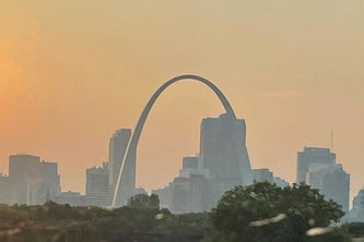 Smoke from wildfires in the western U.S. create haze in the sky over downtown St. Louis as the sun sets Thursday, July 22, 2021. A heat advisory is in effect for Saturday with heat index values up to 105 expected in the St. Louis area. (Michael Collins, mcollins@post-dispatch.com)